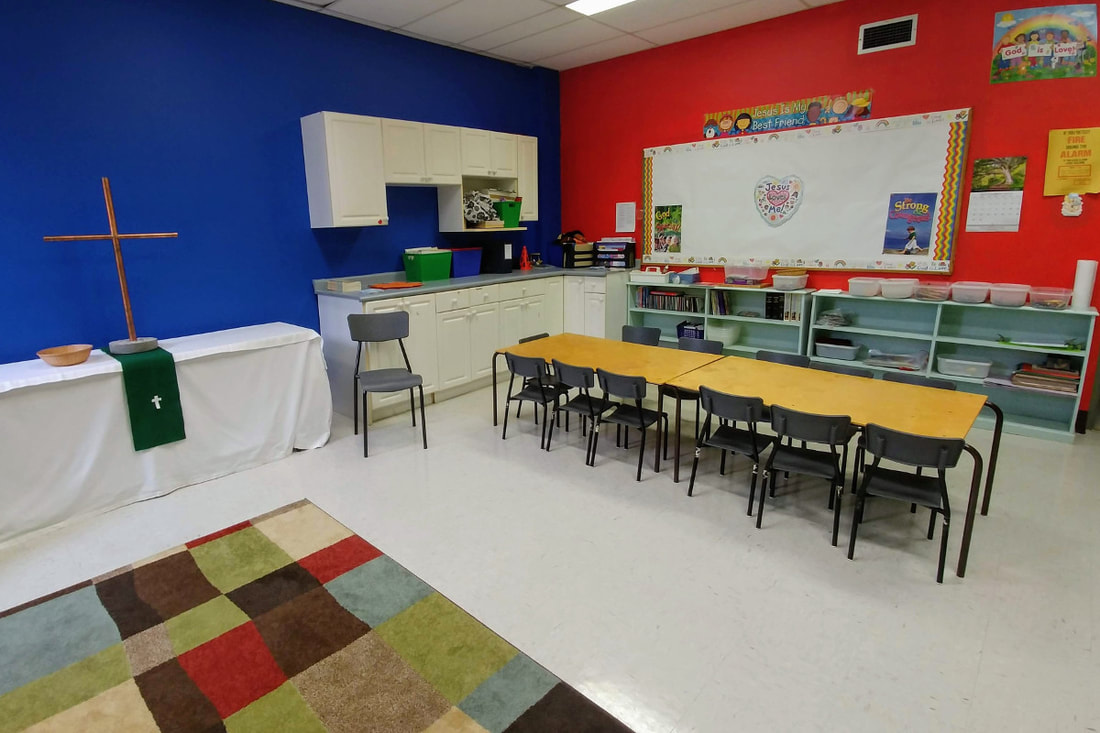 Classroom with chairs and tables for young children
