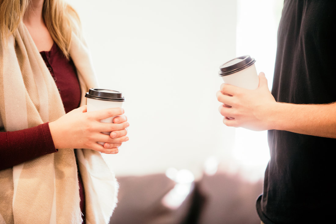 Man and Woman holding coffee cups